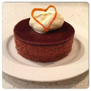 Serve cake with whipped cream and toffee heart